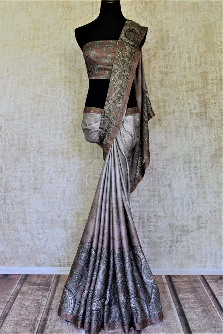 Shop elegant grey and brown printed crepe silk sari online in USA with stone work. Enhance your traditional style at weddings and festive occasions with beautifully curated collection of Banarasi sarees, pure silk sarees, designer saris from Pure Elegance Indian clothing store in USA.-full view