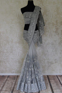 Shop beautiful grey pearl and stone net sari online in USA. Bring up your style game with stunning designer sarees, wedding sarees, Bollywood sarees from Pure Elegance Indian boutique in USA.-full view