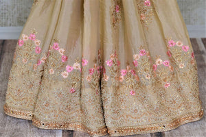 Buy stunning beige pearl embroidery chiffon saree online in USA. Enhance your traditional saree style at weddings and festive occasions with designer sarees with blouse, handwoven sarees from Pure Elegance Indian clothing store in USA.-pleats