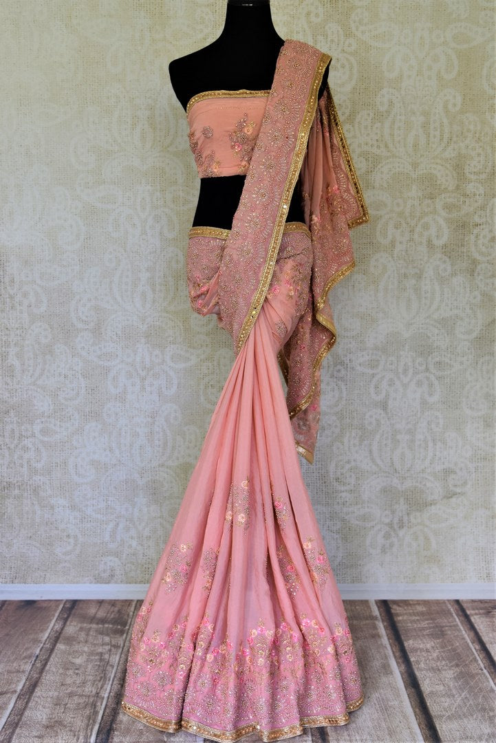 Shop beautiful dusty pink pearl embroidery chiffon sari online in USA. Enhance your traditional saree style at weddings and festive occasions with designer sarees with blouse, handwoven sarees from Pure Elegance Indian clothing store in USA.-full view