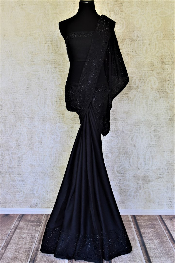 Shop black designer crepe silk saree online in USA with stone work. Enhance your traditional style at weddings and festive occasions with beautifully curated collection of Banarasi sarees, pure silk sarees, designer saris from Pure Elegance Indian clothing store in USA.-full view