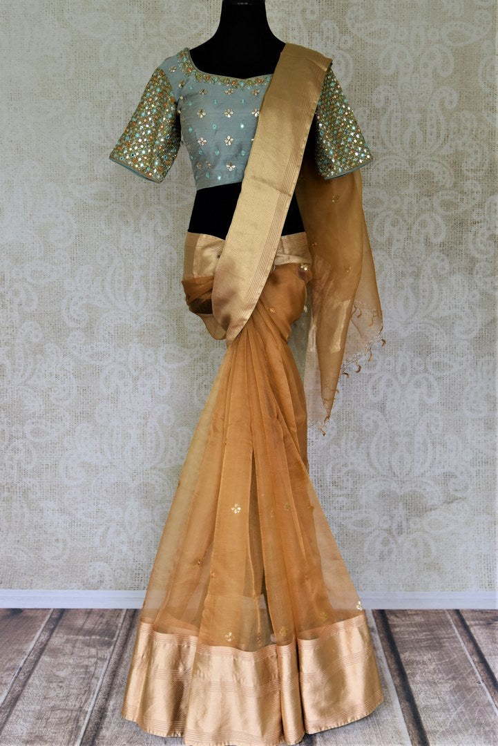 Shop stunning brown organza saree online in USA with blue gota patti saree blouse. Enter the world of exquisite designer sarees and Indian clothing at Pure Elegance Indian clothing store in USA. Shop handwoven sarees, Banarasi sarees, soft silk sarees online or from our store.-full view