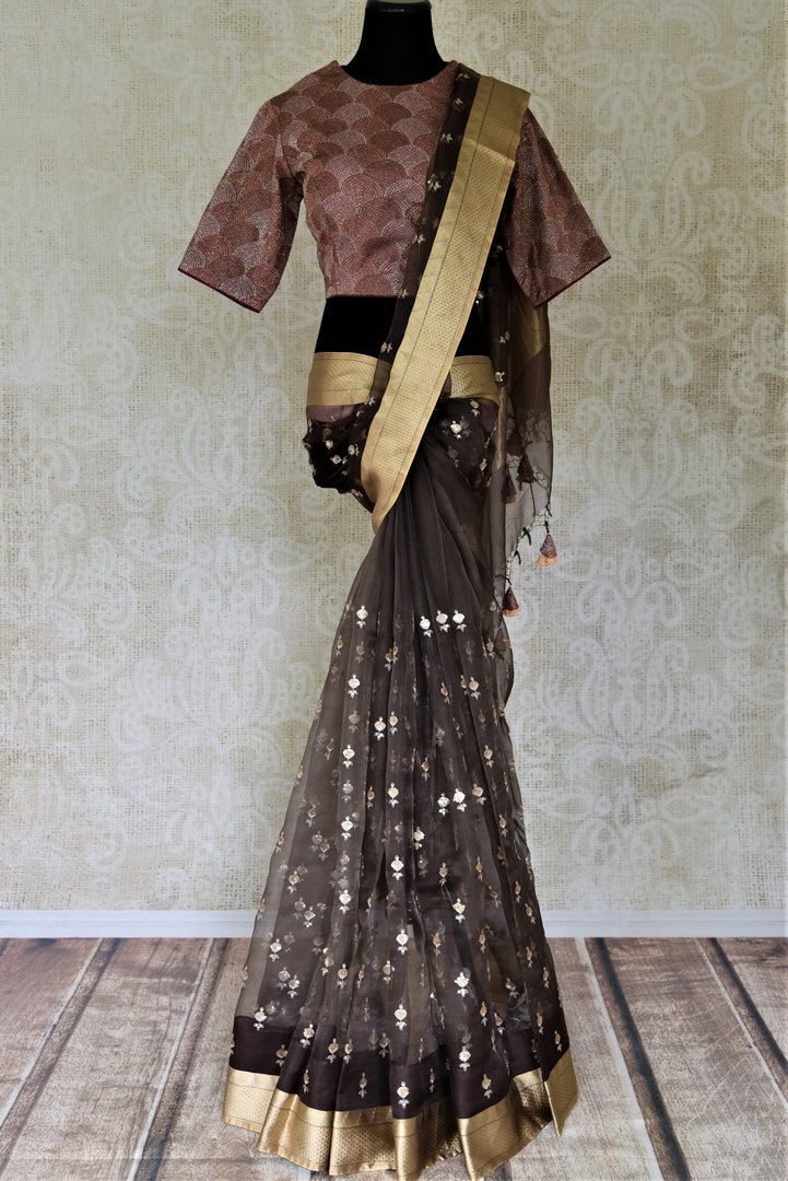 Buy ravishing black embroidered organza saree online in USA with purple saree blouse. Enter the world of exquisite designer sarees and Indian clothing at Pure Elegance Indian clothing store in USA. Shop handwoven sarees, Banarasi sarees, soft silk sarees online or from our store.-full view