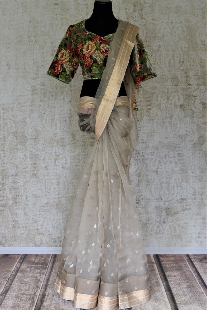 Buy charming light grey embroidered organza sari online in USA with floral velvet sari blouse. Enter the world of exquisite designer sarees and Indian clothing at Pure Elegance Indian clothing store in USA. Shop handwoven saris, Banarasi sarees, soft silk sarees online or from our store.-full view