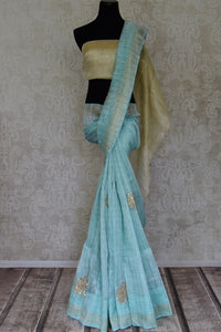 Shop beautiful light blue gota patti work check linen sari online in USA. Be the talk of parties and weddings with exquisite handloom sarees, embroidered sarees from Pure Elegance Indian clothing store in USA. Shop online now.-full view