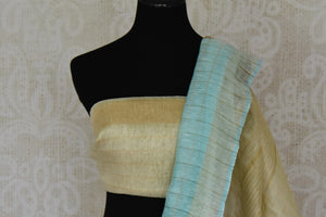 Shop beautiful light blue gota patti work check linen sari online in USA. Be the talk of parties and weddings with exquisite handloom sarees, embroidered sarees from Pure Elegance Indian clothing store in USA. Shop online now.-blouse pallu