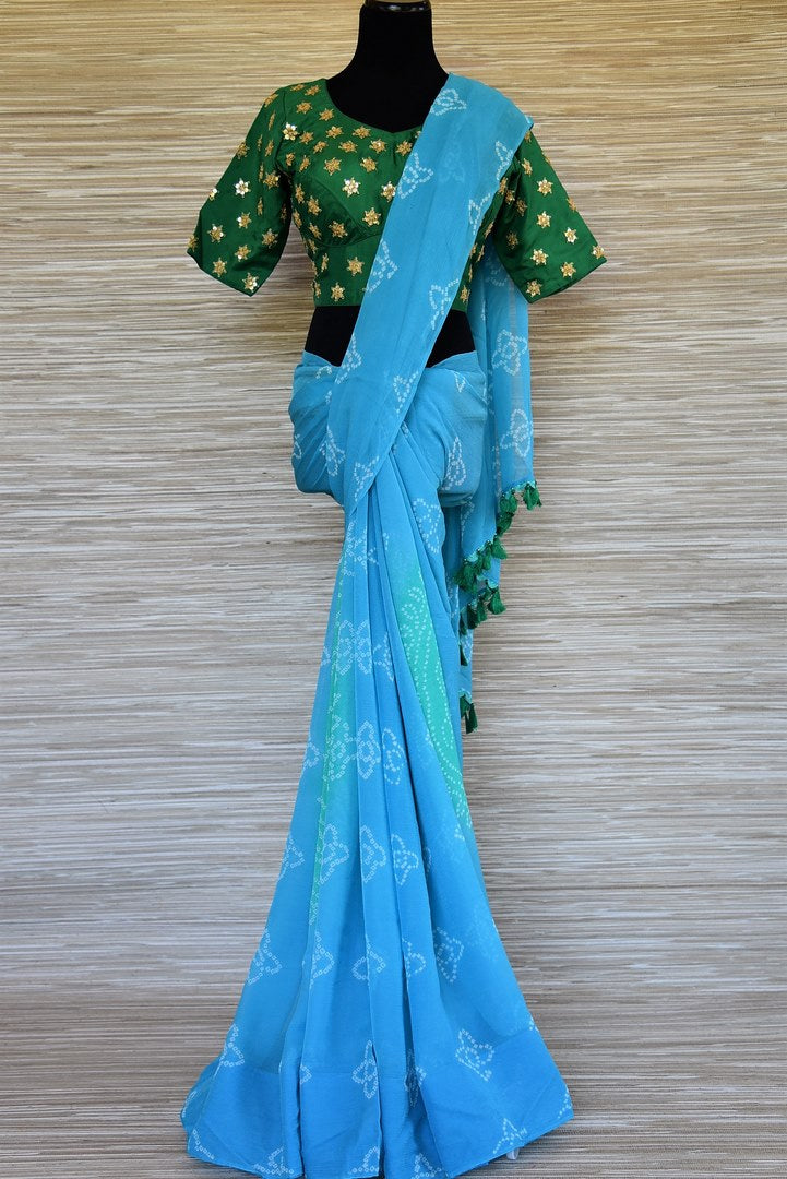 Shop elegant sky blue Bandhej chiffon saree online in USA with embroidered green saree blouse. Be an epitome of elegance and tradition in exquisite designer saris, handwoven saris from Pure Elegance clothing store in USA. -full view