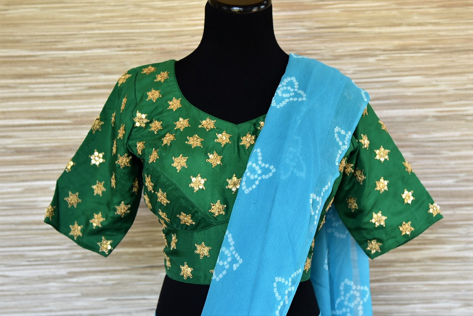 Shop elegant sky blue Bandhej chiffon saree online in USA with embroidered green saree blouse. Be an epitome of elegance and tradition in exquisite designer saris, handwoven saris from Pure Elegance clothing store in USA. -blouse pallu
