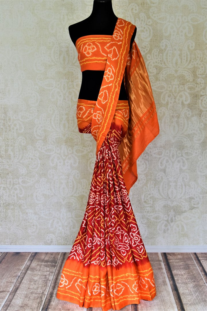 Shop red bandhej print gajji silk sari online in USA with orange border. Turn heads at parties and weddings with exquisite designer saris with blouse, handloom sarees, embroidered sarees from Pure Elegance Indian clothes store in USA.-full view