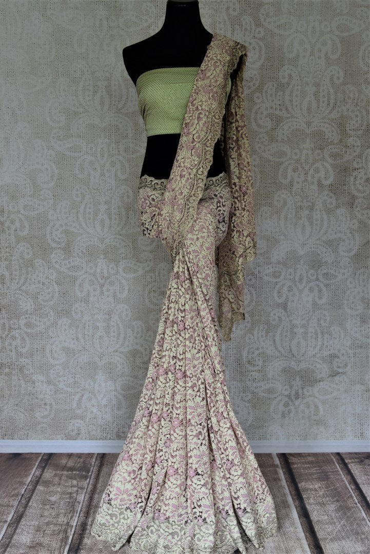 Shop contemporary mint green and pink lace saree online in USA with stone work. Embrace ethnic elegance in stunning designer sarees, embroidered sarees with blouses, partywear sarees from Pure Elegance from Indian cloth store in USA.  Shop online or visit our store now.-full view