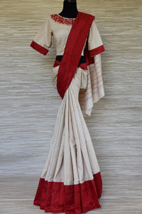 Buy cream tussar saree online in USA with red border and embroidered blouse. Update your saree wardrobe this festive season with latest designer sarees. soft silk sarees, handwoven saris from Pure Elegance Indian cloth store in USA. Shop online  now.-full view