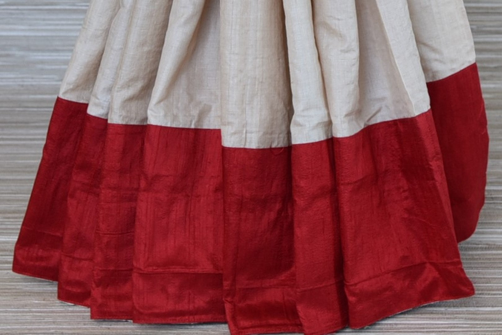 Buy cream tussar saree online in USA with red border and embroidered blouse. Update your saree wardrobe this festive season with latest designer sarees. soft silk sarees, handwoven saris from Pure Elegance Indian cloth store in USA. Shop online  now.-pleats