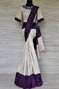 Buy stunning cream tussar sari online in USA with purple border and embroidered saree blouse. Grab exquisite handwoven sarees, embroidered saris, designer sarees with blouse for the coming festive and wedding season from Pure Elegance Indian boutique in USA. Shop online now.-full view