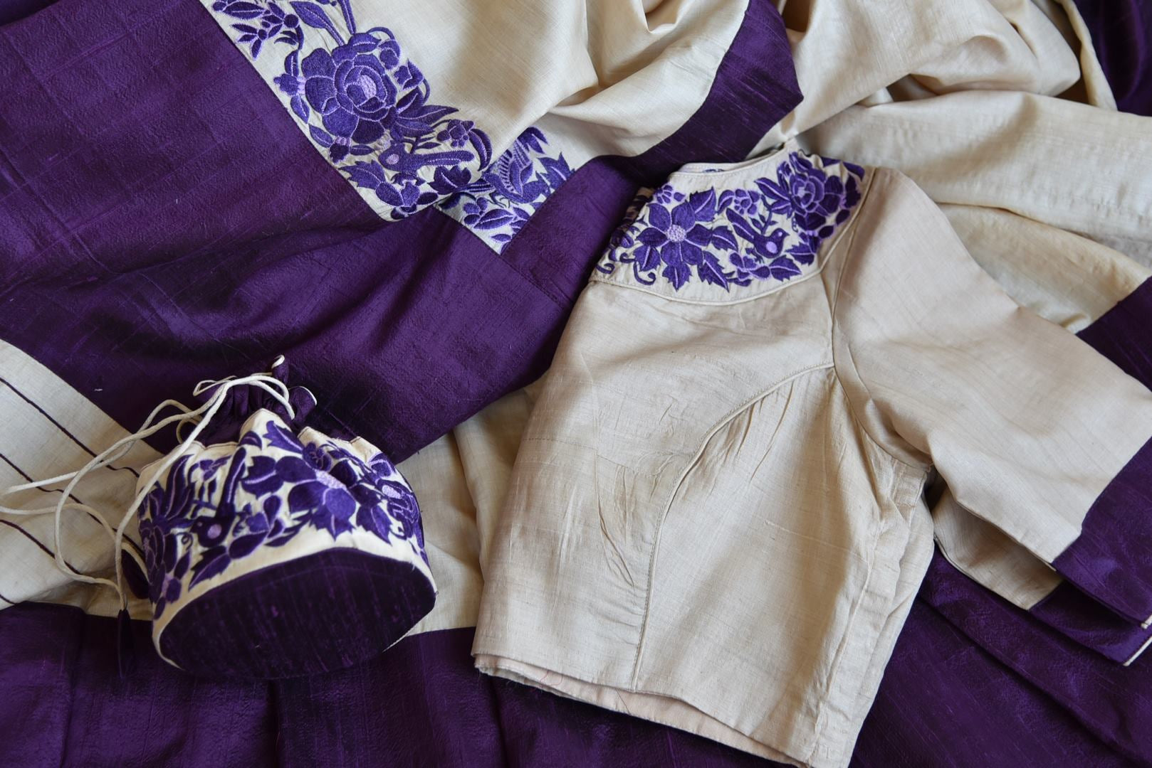 Buy stunning cream tussar sari online in USA with purple border and embroidered saree blouse. Grab exquisite handwoven sarees, embroidered saris, designer sarees with blouse for the coming festive and wedding season from Pure Elegance Indian boutique in USA. Shop online now.-details