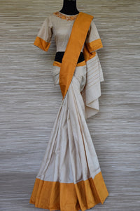 Buy lovely cream color tussar saree online in USA with yellow border and embroidered saree blouse. Grab exquisite handwoven sarees, embroidered saris, designer sarees with blouse for the coming festive and wedding season from Pure Elegance Indian boutique in USA. Shop online now.-full view