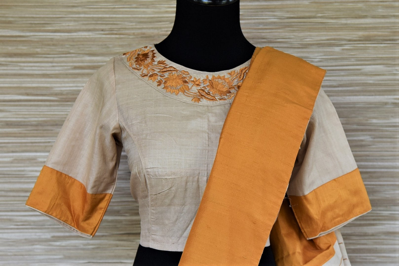 Buy lovely cream color tussar saree online in USA with yellow border and embroidered saree blouse. Grab exquisite handwoven sarees, embroidered saris, designer sarees with blouse for the coming festive and wedding season from Pure Elegance Indian boutique in USA. Shop online now.-blouse pallu