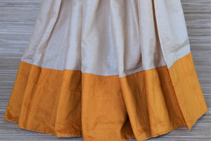Buy lovely cream color tussar saree online in USA with yellow border and embroidered saree blouse. Grab exquisite handwoven sarees, embroidered saris, designer sarees with blouse for the coming festive and wedding season from Pure Elegance Indian boutique in USA. Shop online now.-pleats