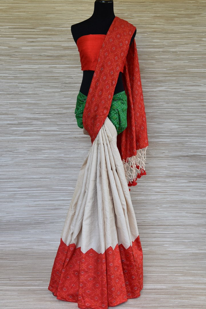 Shop cream tussar sari online in USA with red and green ikkat border. Update your saree wardrobe this festive season with latest designer sarees. soft silk sarees, handwoven saris from Pure Elegance Indian cloth store in USA. Shop online  now.-full view