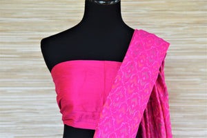 Shop gorgeous cream tussar raw silk sari online in USA with blue and pink ikat border. Grab exquisite handwoven sarees, embroidered saris, pure silk sarees for the coming festive and wedding season from Pure Elegance Indian boutique in USA. Shop online now.-blouse pallu