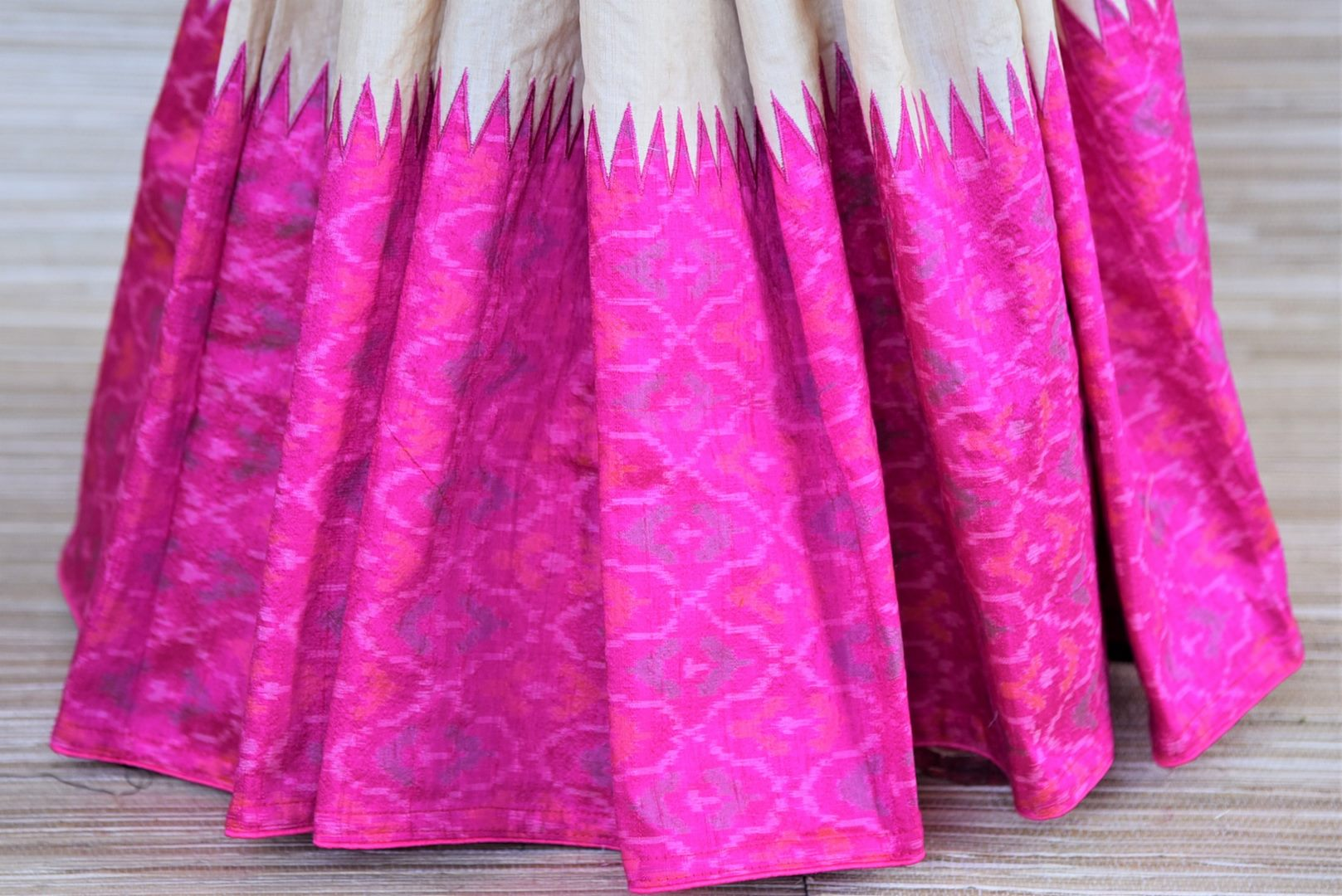Shop gorgeous cream tussar raw silk sari online in USA with blue and pink ikat border. Grab exquisite handwoven sarees, embroidered saris, pure silk sarees for the coming festive and wedding season from Pure Elegance Indian boutique in USA. Shop online now.-pleats