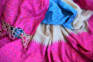 Shop gorgeous cream tussar raw silk sari online in USA with blue and pink ikat border. Grab exquisite handwoven sarees, embroidered saris, pure silk sarees for the coming festive and wedding season from Pure Elegance Indian boutique in USA. Shop online now.-details