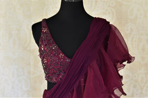 Shop stylish purple designer ruffle saree online in USA with embroidered blouse. Enhance your traditional saree style at weddings and festive occasions with designer sarees with blouse, handwoven sarees from Pure Elegance Indian clothing store in USA.-front
