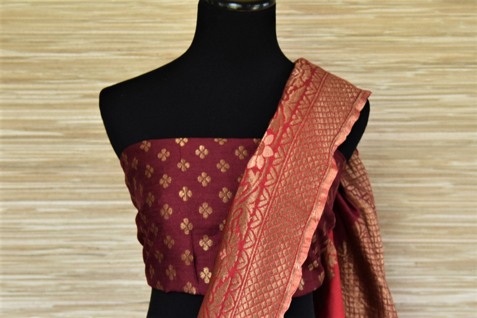 Buy maroon two-tone muga Benarasi saree online in USA with zari border. Grab exquisite Banarasi saris, embroidered saris, pure silk sarees for the coming festive and wedding season from Pure Elegance Indian boutique in USA. Shop online now.-blouse pallu