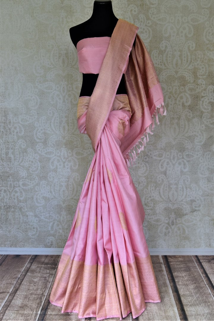 Buy baby pink Kanjivaram saree online in USA with zari border and zari pallu. Go for rich traditional festive look with beautiful Kanchipuram silk sarees, soft silk sarees, Banarasi silk saris from Pure Elegance Indian cloth store in USA. -full view