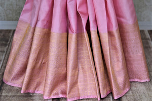 Buy baby pink Kanjivaram saree online in USA with zari border and zari pallu. Go for rich traditional festive look with beautiful Kanchipuram silk sarees, soft silk sarees, Banarasi silk saris from Pure Elegance Indian cloth store in USA. -pleats