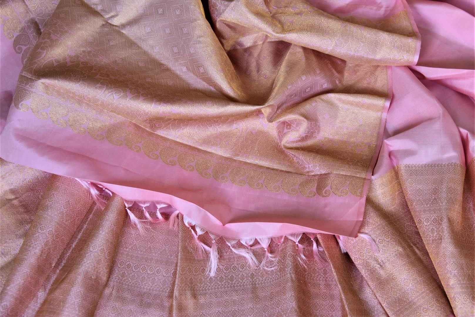 Buy baby pink Kanjivaram saree online in USA with zari border and zari pallu. Go for rich traditional festive look with beautiful Kanchipuram silk sarees, soft silk sarees, Banarasi silk saris from Pure Elegance Indian cloth store in USA. -details