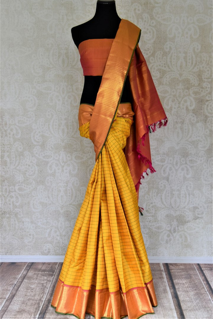 Beautiful yellow check Kanjivaram saree for online shopping in USA with golden zari border. Buy exquisite Kanchipuram silk sarees from Pure Elegance Indian clothing store in USA for weddings and festive occasions.-full view