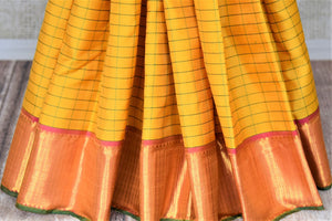 Beautiful yellow check Kanjivaram saree for online shopping in USA with golden zari border. Buy exquisite Kanchipuram silk sarees from Pure Elegance Indian clothing store in USA for weddings and festive occasions.-pleats
