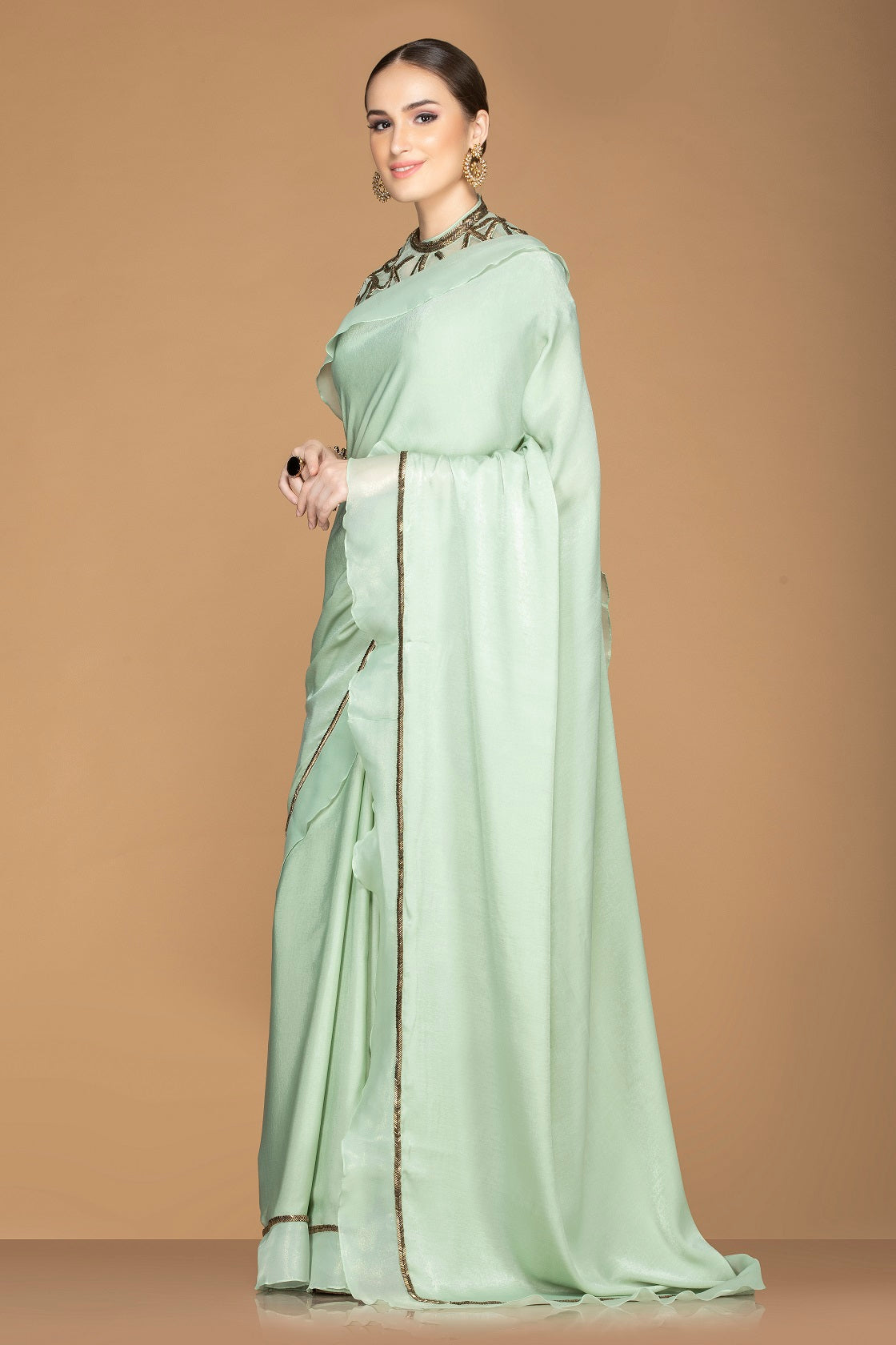 Shop mint green designer crepe saree online in USA with embroidered blouse. Keep your ethnic fashion on point with exquisite designer sarees, partywear sarees, embroidered sarees from Pure Elegance Indian fashion boutique in USA.-side