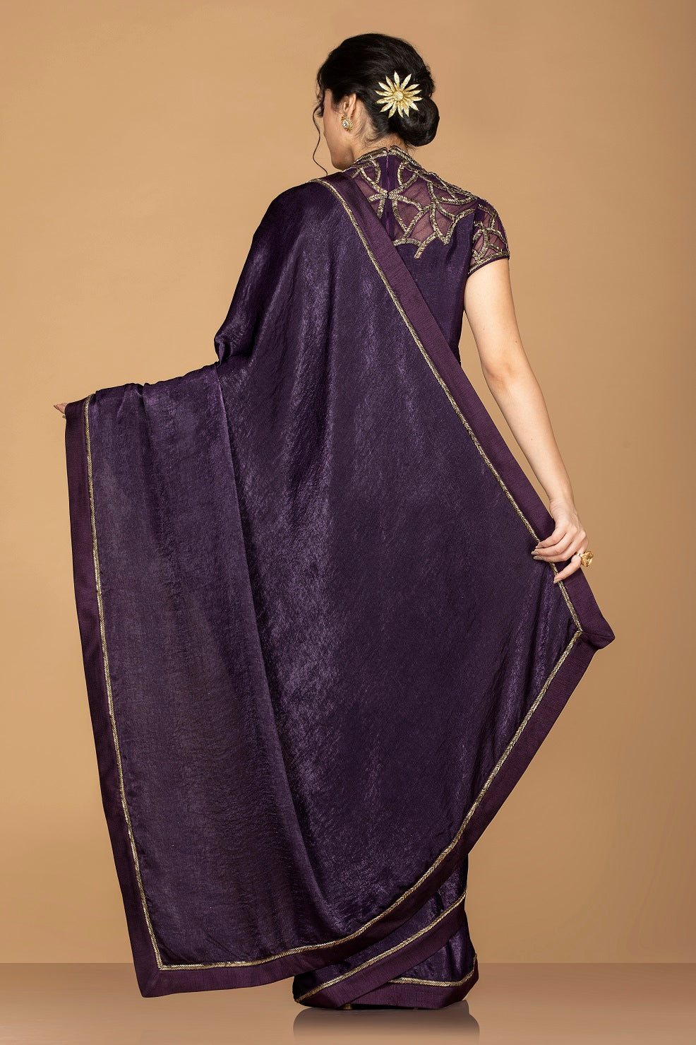 Shop ravishing purple designer sari online in USA with embroidered blouse. Keep your ethnic fashion on point with exquisite designer sarees, partywear sarees, embroidered sarees from Pure Elegance Indian fashion boutique in USA.-back