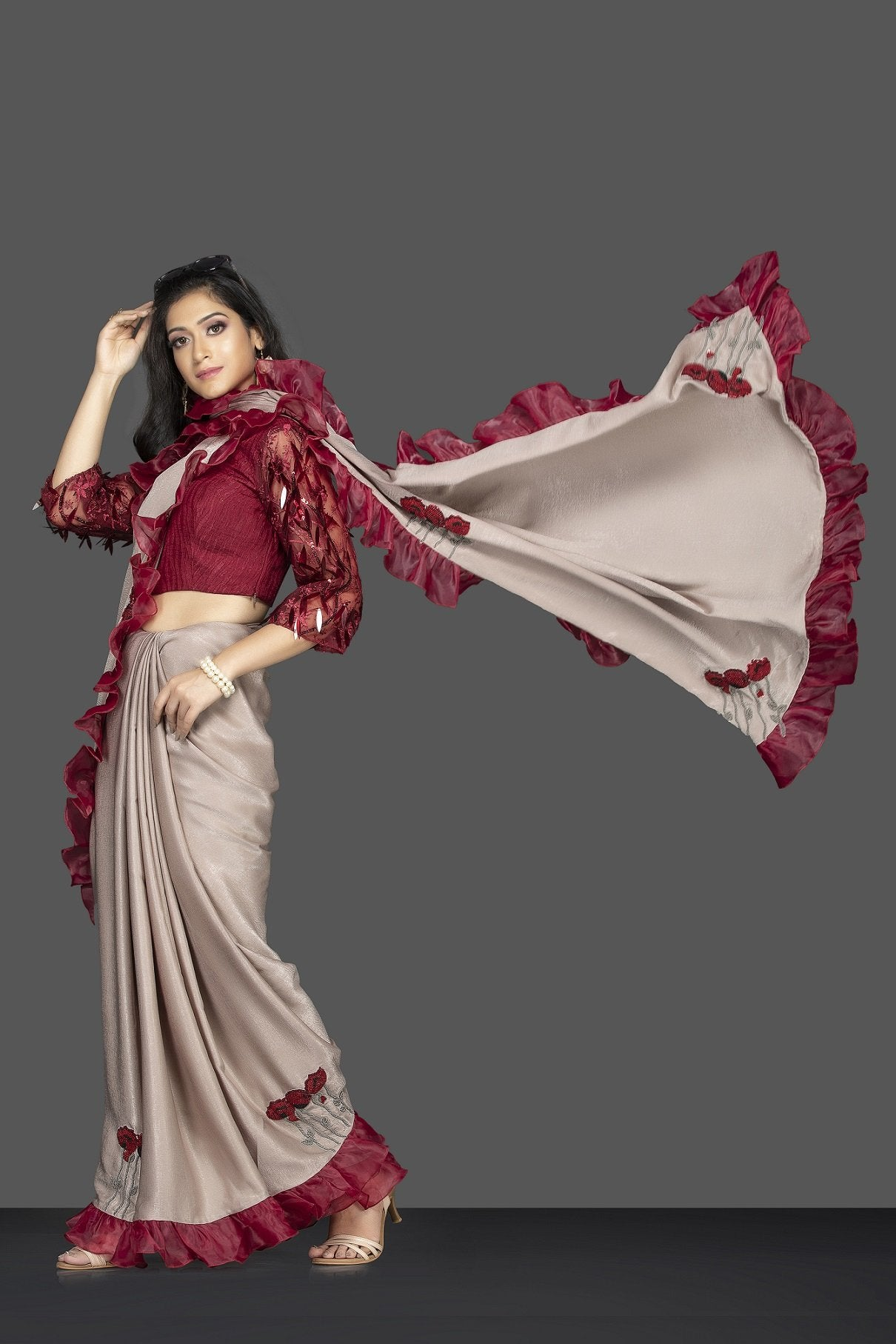 Buy beige embroidered saree with ruffle border online in USA and maroon embroidered sari blouse. Elevate your sartorial choice with exclusive Indian designer sarees with blouse, embroidered sarees, pure silk sarees from Pure Elegance Indian fashion store in USA.-full view
