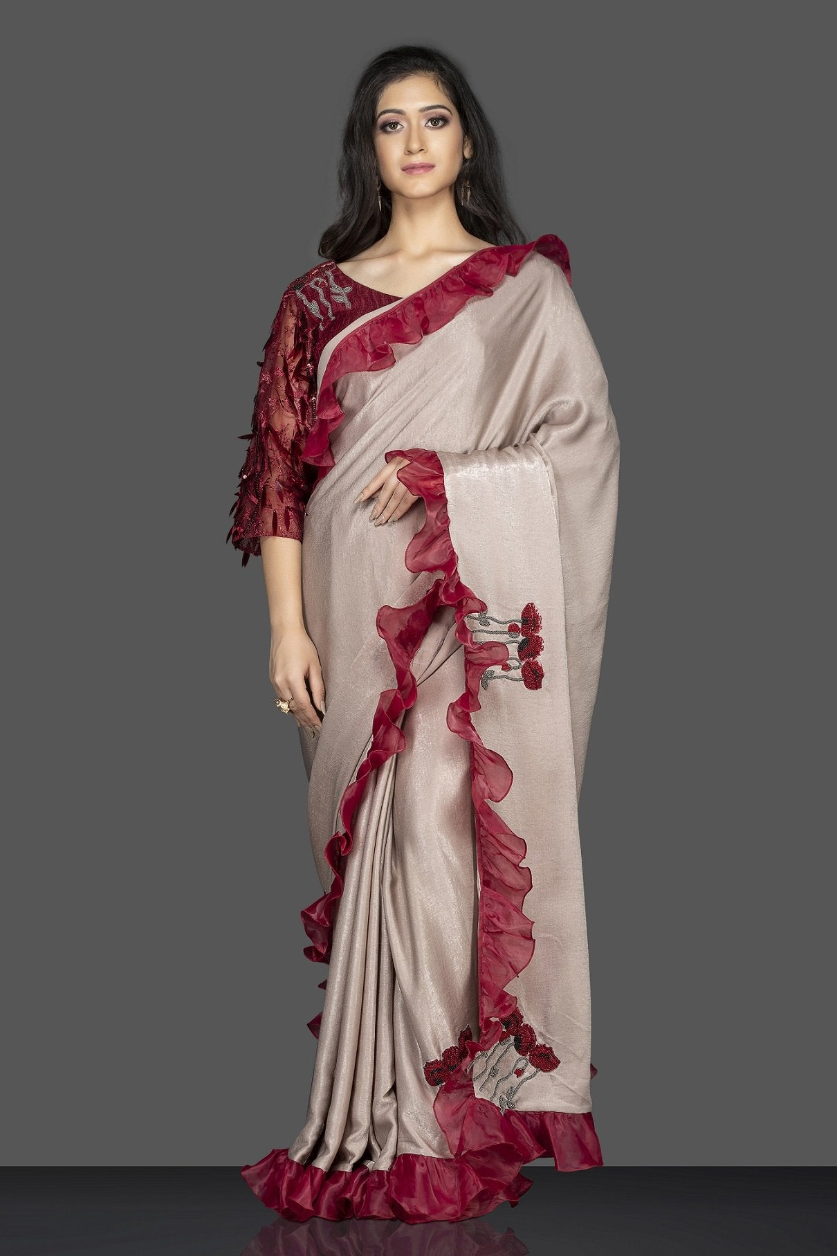 Buy beige embroidered saree with ruffle border online in USA and maroon embroidered sari blouse. Elevate your sartorial choice with exclusive Indian designer sarees with blouse, embroidered sarees, pure silk sarees from Pure Elegance Indian fashion store in USA.-front