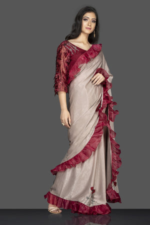 Buy beige embroidered saree with ruffle border online in USA and maroon embroidered sari blouse. Elevate your sartorial choice with exclusive Indian designer sarees with blouse, embroidered sarees, pure silk sarees from Pure Elegance Indian fashion store in USA.-side