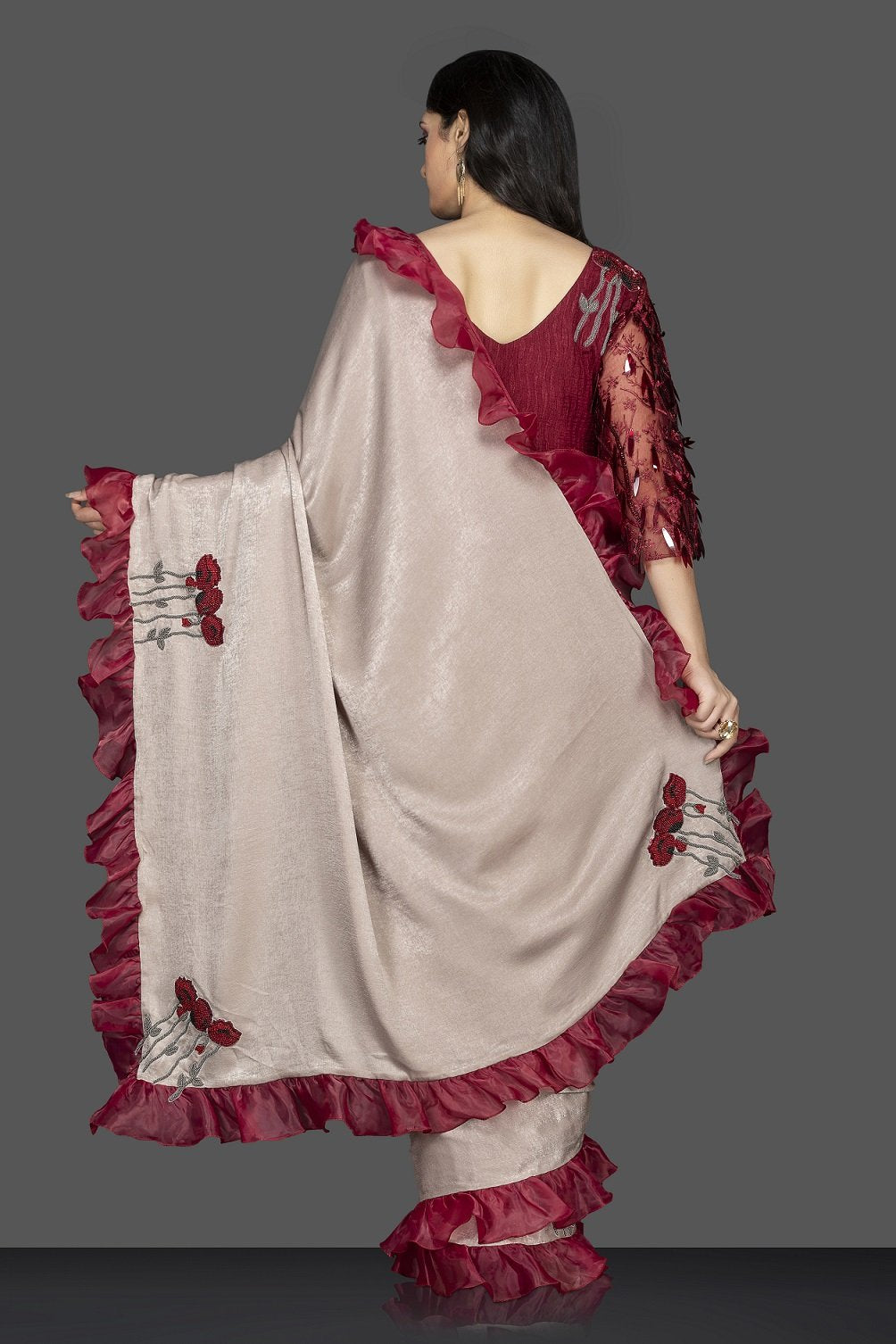 Buy beige embroidered saree with ruffle border online in USA and maroon embroidered sari blouse. Elevate your sartorial choice with exclusive Indian designer sarees with blouse, embroidered sarees, pure silk sarees from Pure Elegance Indian fashion store in USA.-back