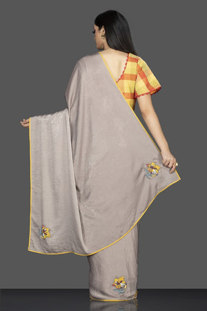 Shop grey and yellow designer saree online in USA and check saree blouse. Elevate your sartorial choice with exclusive Indian designer sarees with blouse, embroidered sarees, pure silk sarees from Pure Elegance Indian fashion store in USA.-back
