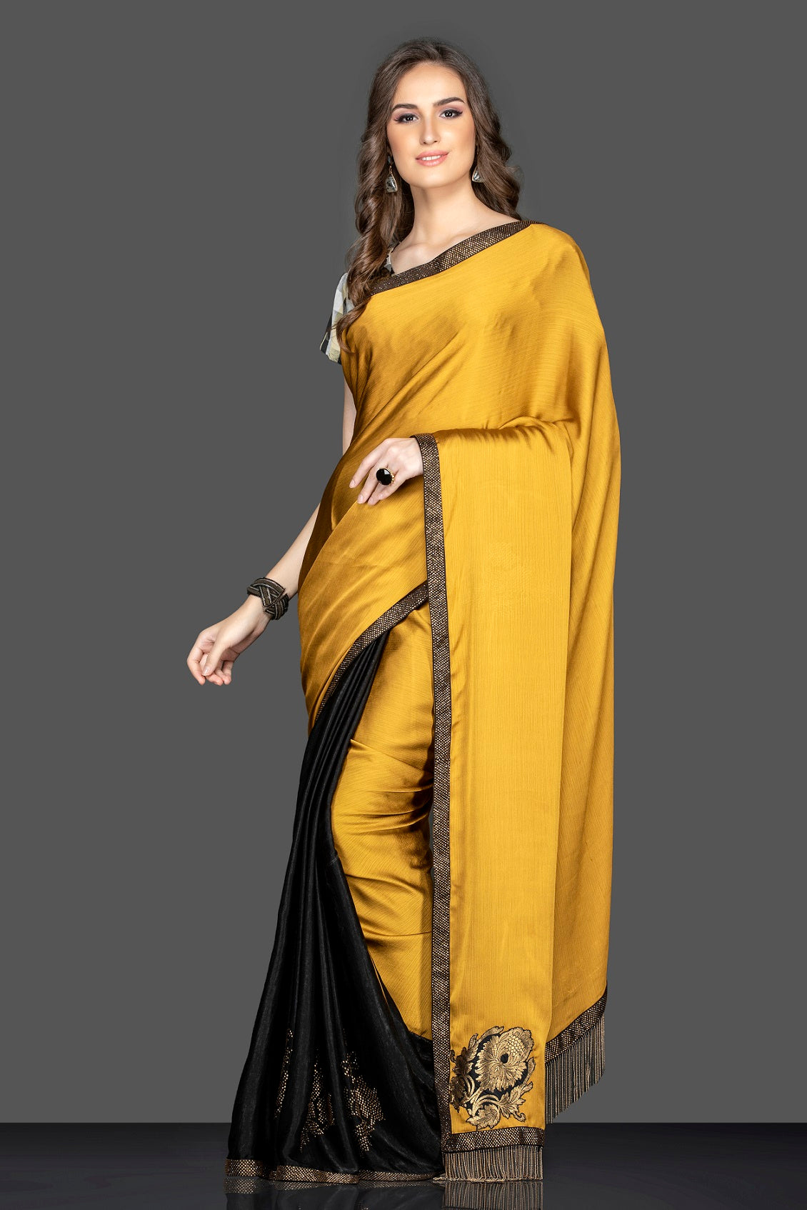 Shop beautiful mustard and black embroidered sari online in USA with designer sari blouse. Elevate your sartorial choice with exclusive Indian designer saris with blouse, embroidered sarees, pure silk sarees from Pure Elegance Indian fashion store in USA.-full view