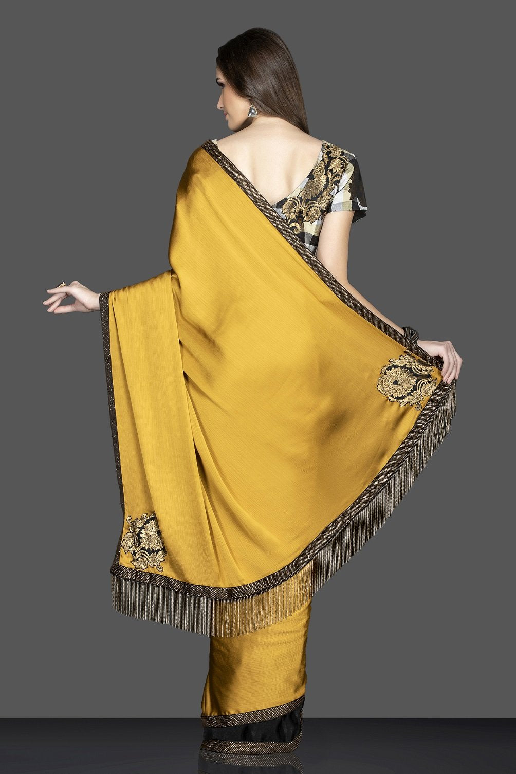 Shop beautiful mustard and black embroidered sari online in USA with designer sari blouse. Elevate your sartorial choice with exclusive Indian designer saris with blouse, embroidered sarees, pure silk sarees from Pure Elegance Indian fashion store in USA.-back