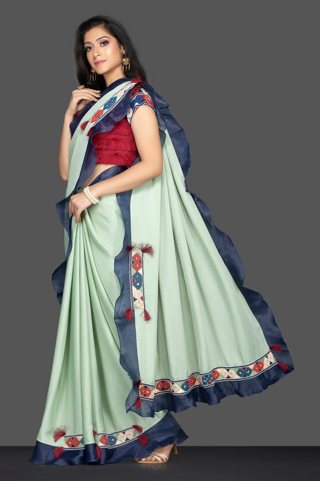 Shop beautiful mint green embroidered sari online in USA with blue ruffle border and maroon saree blouse. Elevate your sartorial choice with exclusive Indian designer sarees with blouse, embroidered sarees, pure silk sarees from Pure Elegance Indian fashion store in USA.-full view