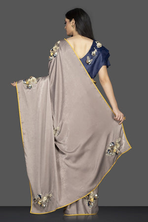 Buy stunning grey embroidered designer sari online in USA and embroidered blue saree blouse. Elevate your sartorial choice with exclusive Indian designer sarees with blouse, embroidered sarees, party sarees from Pure Elegance Indian fashion store in USA.-back