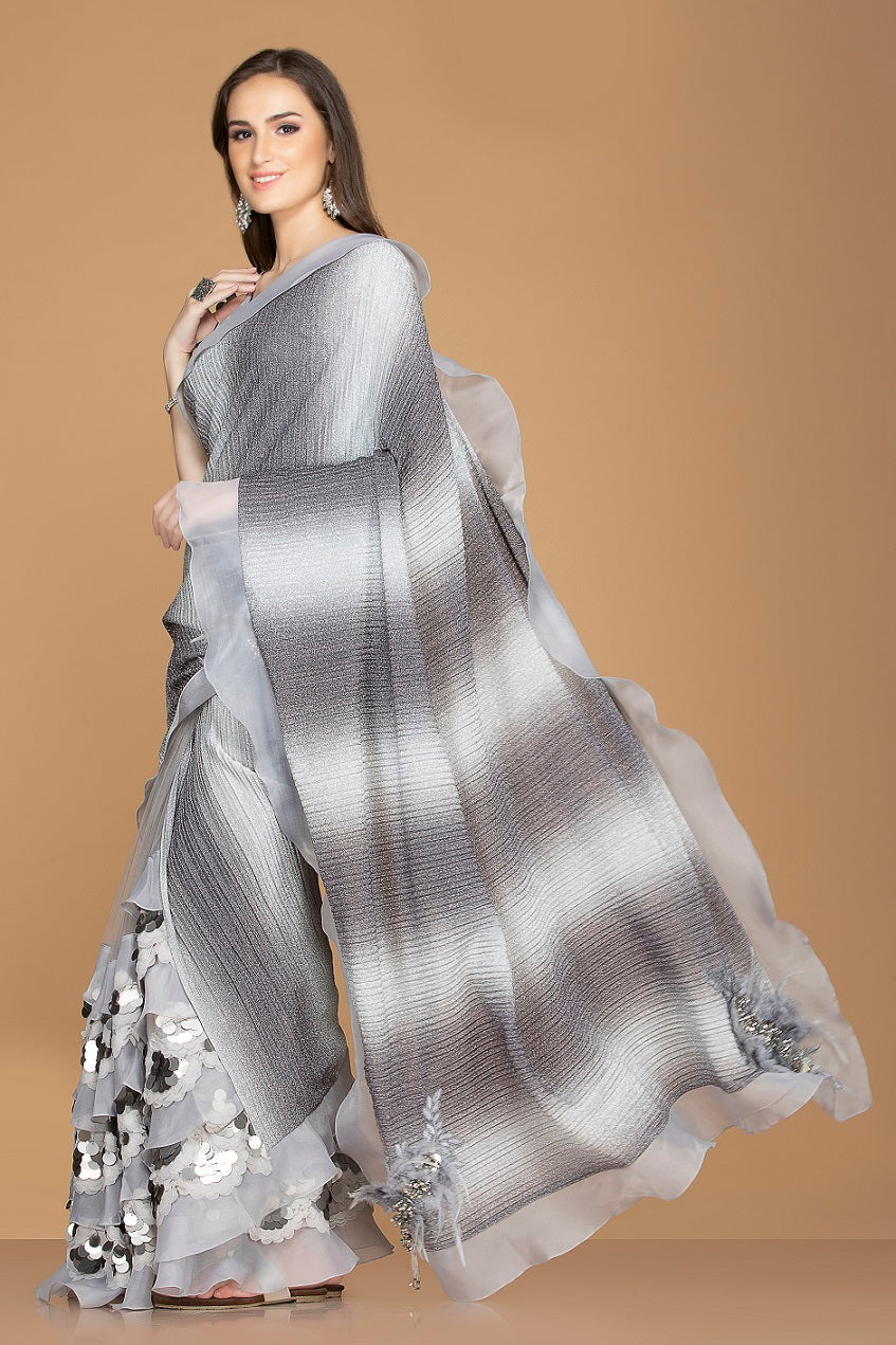 Buy stylish grey and black designer saree online in USA with ruffle border and embroidered saree blouse. Elevate your sartorial choice with exclusive Indian designer sarees with blouse, embroidered sarees, party sarees from Pure Elegance Indian fashion store in USA.-side