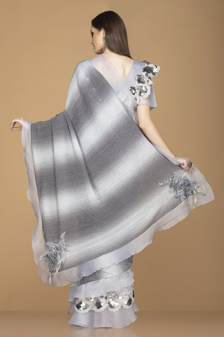 Buy stylish grey and black designer saree online in USA with ruffle border and embroidered saree blouse. Elevate your sartorial choice with exclusive Indian designer sarees with blouse, embroidered sarees, party sarees from Pure Elegance Indian fashion store in USA.-back