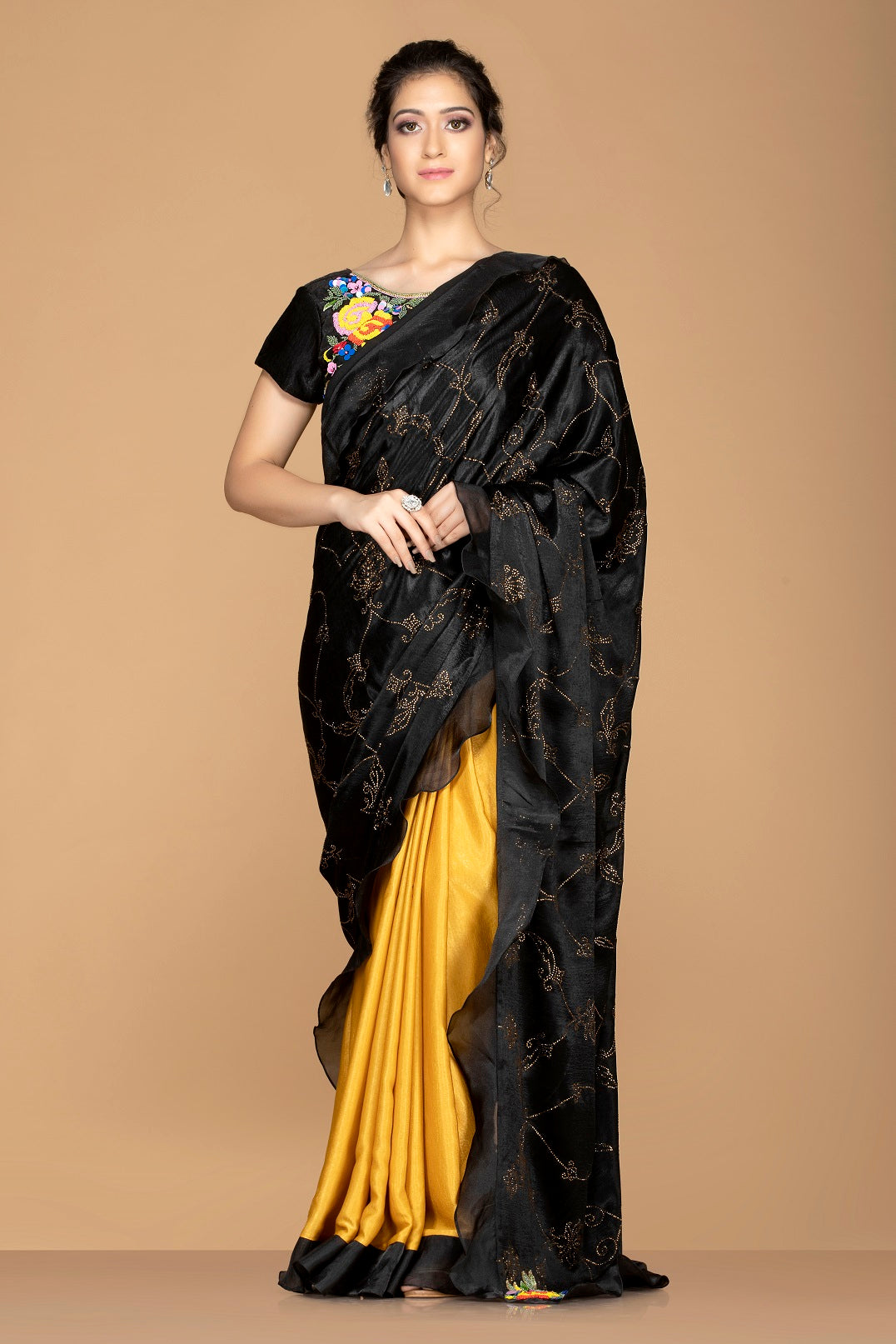 Shop black and mustard embroidered ruffle saree online in USA with embroidered saree blouse. Elevate your sartorial choice with exclusive Indian designer sarees with blouse, embroidered sarees, party sarees from Pure Elegance Indian fashion store in USA.-front