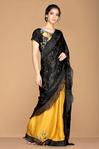 Shop black and mustard embroidered ruffle saree online in USA with embroidered saree blouse. Elevate your sartorial choice with exclusive Indian designer sarees with blouse, embroidered sarees, party sarees from Pure Elegance Indian fashion store in USA.-full view