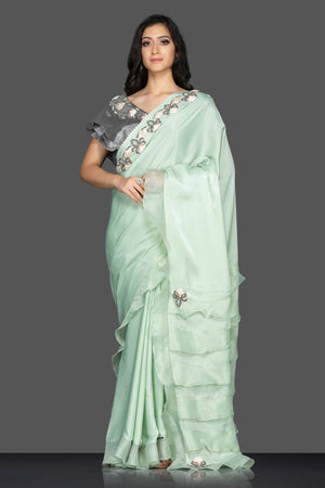 Shop lovely pastel green ruffle sari online in USA with grey embroidered saree blouse. Keep your ethnic fashion on point with exquisite designer sarees, partywear sarees, embroidered sarees from Pure Elegance Indian fashion boutique in USA.-front