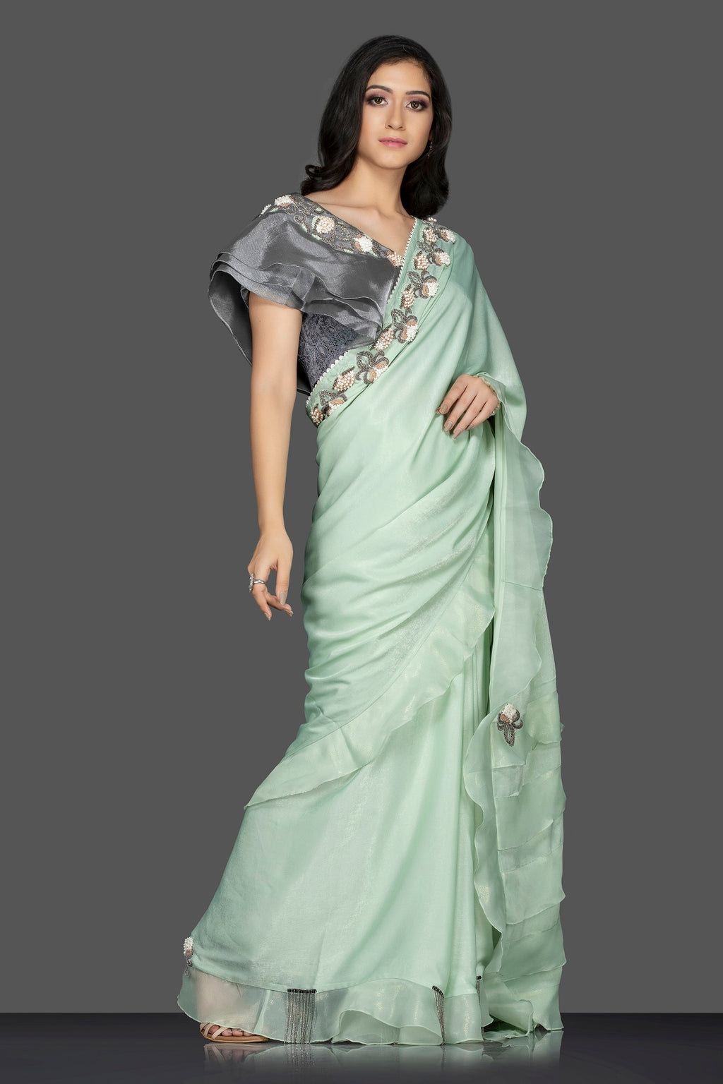 Shop lovely pastel green ruffle sari online in USA with grey embroidered saree blouse. Keep your ethnic fashion on point with exquisite designer sarees, partywear sarees, embroidered sarees from Pure Elegance Indian fashion boutique in USA.-full view