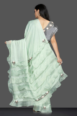 Shop lovely pastel green ruffle sari online in USA with grey embroidered saree blouse. Keep your ethnic fashion on point with exquisite designer sarees, partywear sarees, embroidered sarees from Pure Elegance Indian fashion boutique in USA.-back